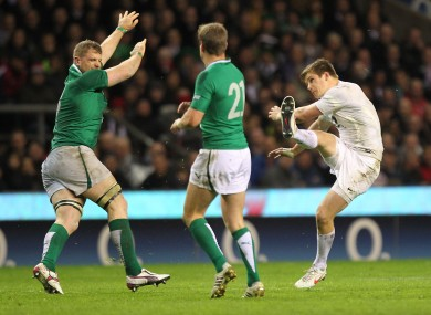 Jamie Heaslip attempts to block an Owen Farrell kick.