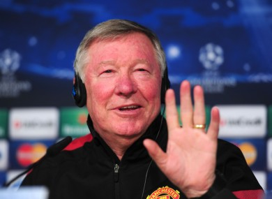 Manchester United's coach Alex Ferguson chats to the press during the press conference at Santiago Bernabeu yesterday.