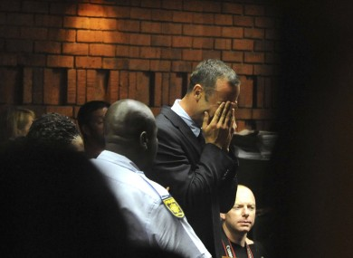 Athlete Oscar Pistorius weeps in court in Pretoria, South Africa, yesterday.