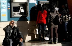 Cyprus postpones crucial vote on unpopular bailout until Tuesday