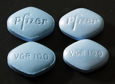 Fake Viagra pills (top and bottom left) beside real ones (top and bottom right)