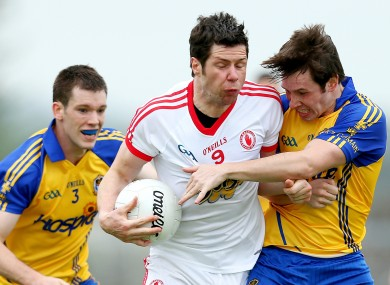 Roscommon's Niall Carty and David Keenan with Sean Cavanagh of Tyrone.