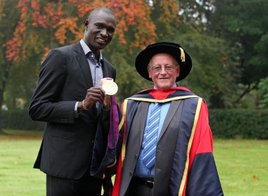 David Rudisha with Brother Colm O'Connell after he received an Honorary Doctorate from Dublin City University.