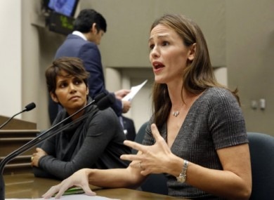Jennifer Garner, right, and Halle Berry, left, testify in the California Capitol in Sacramento.