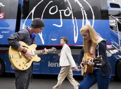 Two young guitarists play outside the John Lennon Educational Bus.