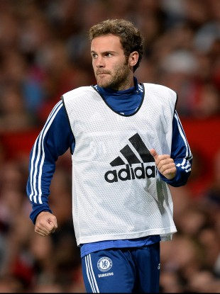 Mata warming up at Old Trafford on Monday.