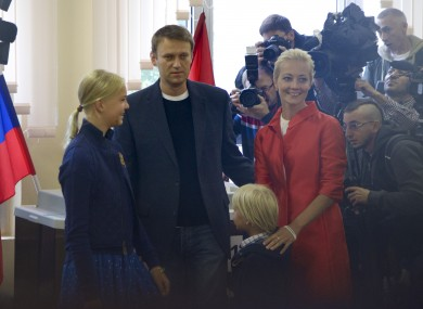 Russian opposition leader Alexei Navalny with his wife Yulia, daughter Daria, and son Zakhar at a polling station in Moscow's mayoral election.