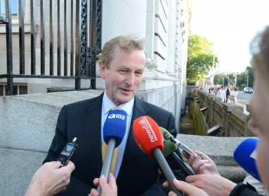 Taoiseach Enda Kenny talks to the media on his way into a cabinet meeting at Government Buildings. (File photo)