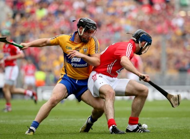 Clare's Colin Ryan and Christopher Joyce of Cork pictured in the previous clash between the sides.