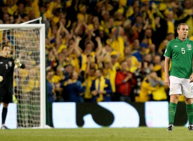A dejected Richard Dunne after Sweden's second goal.