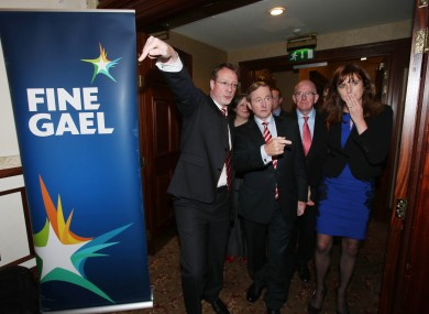Press officers give instructions to Taoiseach Enda Kenny as he arrives at the Fine Gael party think in at the Heritage Hotel in Portlaoise yesterday.
