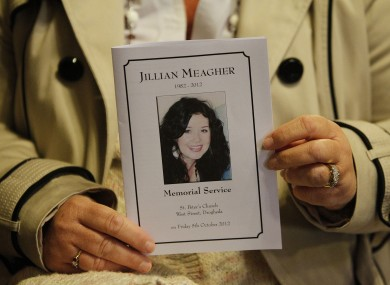 A mourner holds a mass card at the memorial mass for Jill Meagher in Louth last year.