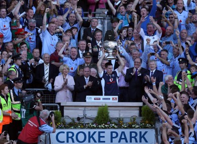 Dublin captain Stephen Cluxton raises the Sam Maguire trophy.