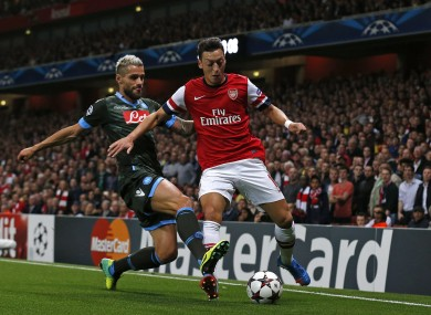 Özil is challenged by Napoli's Valon Behrami.