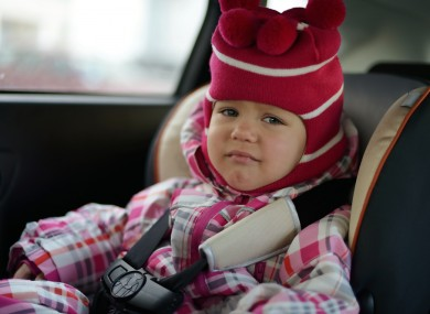 Child in car seat.