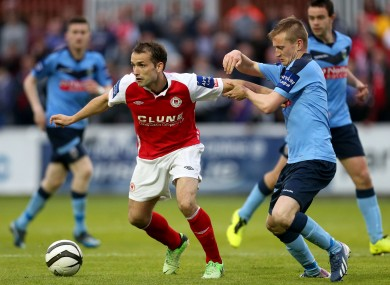 Pat's striker Christy Fagan and Barry McCabe of UCD.