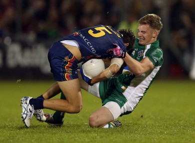 Jarrod Harbrow tussles with Louth youngster Ciaran Byrne.