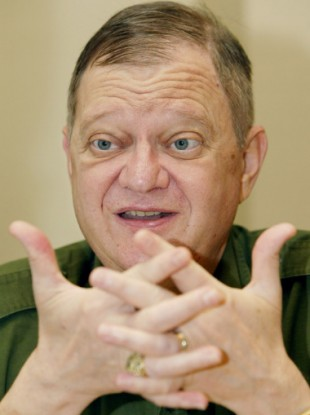 Tom Clancy, hawkish master of military thrillers, gestures during an interview. (File photo)