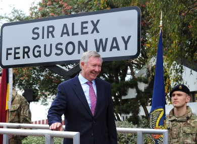 Sir Alex Ferguson unveils the street sign during a ceremony to mark the changing of the road name to Sir Alex Ferguson Way, Trafford.