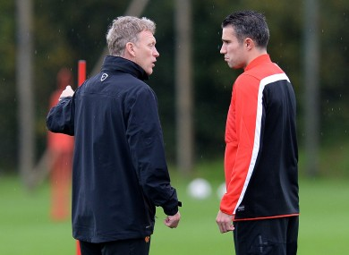 David Moyes speaks to Robin van Persie in training yesterday.